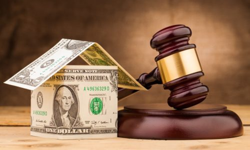 judge gavel with money house closeup
