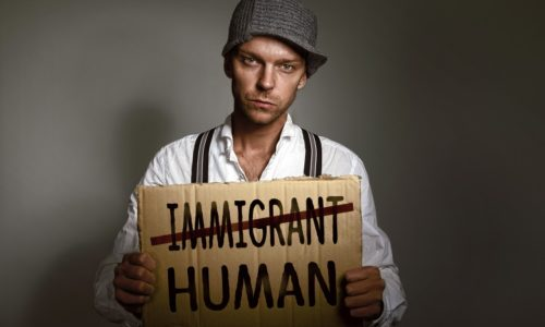 Immigrant holding protest sign